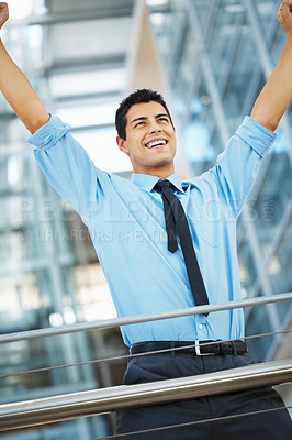 Buy stock photo Executive standing and throwing arms up in excitement
