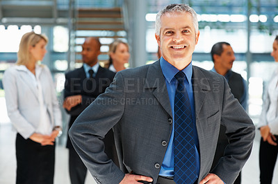 Buy stock photo Successful business man with team in background