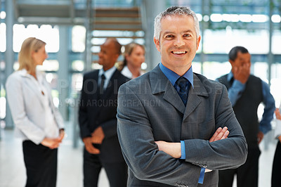 Buy stock photo Friendly senior executive with arms folded