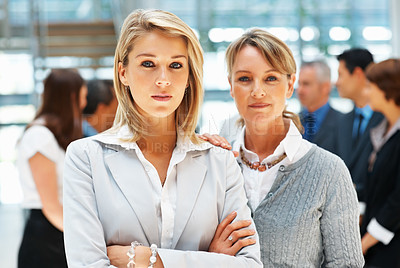 Buy stock photo Businesswoman standing close together with colleagues in background