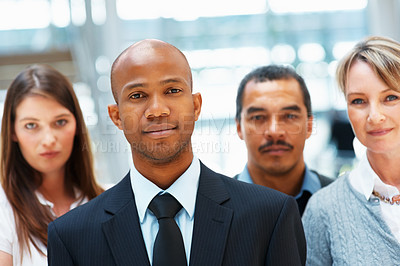 Buy stock photo Group of executives giving serious look