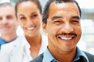 Buy stock photo Happy businessman with colleagues behind him