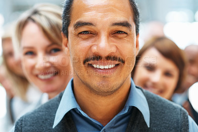 Buy stock photo Closeup of businessman with colleagues in background