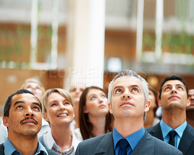 Buy stock photo Group of executives looking up at something