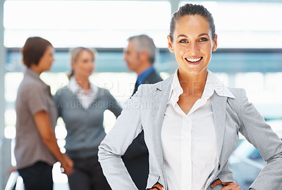 Buy stock photo Focus on confident businesswoman with colleagues in background