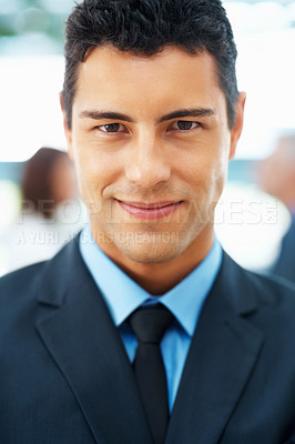 Buy stock photo Closeup of executive with team in distance