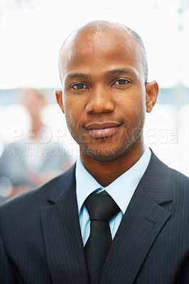 Buy stock photo Portrait of serious businessman with colleague in background