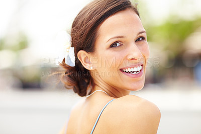 Buy stock photo Smiling young woman looking behind - Outdoors