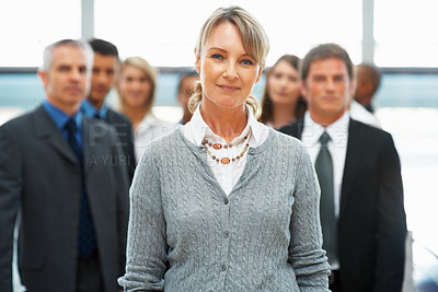 Buy stock photo Confident business woman with colleagues in background