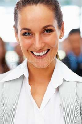 Buy stock photo Closeup of businesswoman with colleagues in background