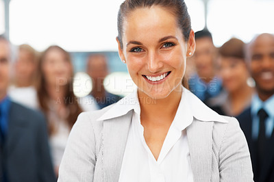 Buy stock photo Happy and confident businesswoman with colleagues in distance