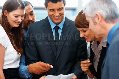 Buy stock photo Group of executives discussing business proposal