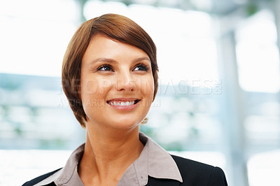 Buy stock photo Closeup of young executive looking off into distance