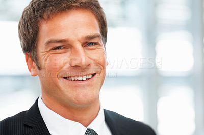 Buy stock photo Closeup of handsome male executive smiling - copyspace