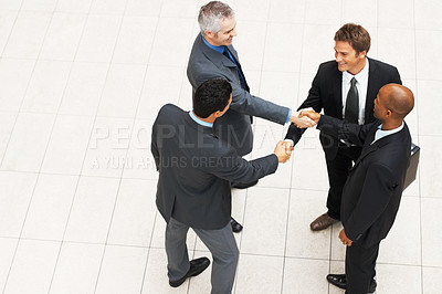 Buy stock photo Top view of group of business men shaking hands