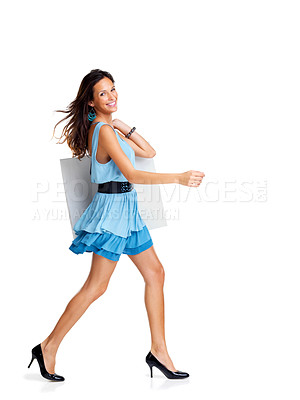 Buy stock photo Fashionable young woman with a handbag walking on white background - Copyspace