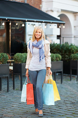 Buy stock photo Full length of happy young woman with shopping bags - outdoors