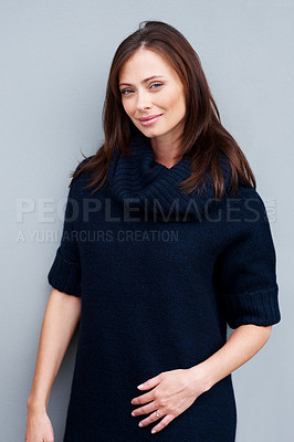 Buy stock photo Portrait of cute young woman standing against grey background