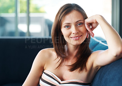 Buy stock photo Portrait of a beautiful young woman sitting on sofa at home - Indoor