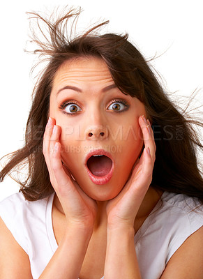 Buy stock photo Surprise - A very surprised woman- Close-up of a young woman with wind in her hair looking very surprised.