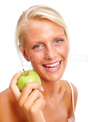 Buy stock photo Portrait of a happy young female with a green apple over white background