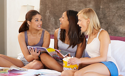 Buy stock photo Shot of a group of female friends hanging out together at home