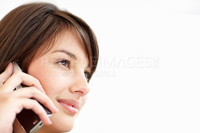 Buy stock photo Closeup of a woman conversing on mobile ove