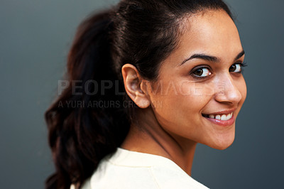 Buy stock photo Closeup portrait of a beautiful young woman smiling against grey background