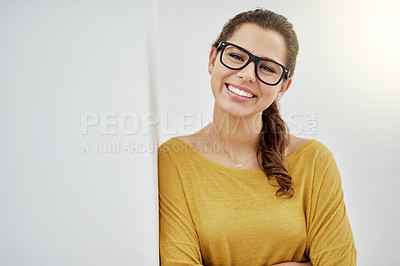 Buy stock photo Portrait of an attractive young woman standing with her arms folded against a grey background