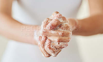 Buy stock photo Closeup shot of a woman washing her hands with soap