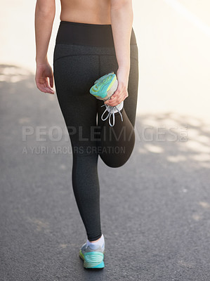 Buy stock photo Rearview shot of an unrecognizable young woman stretching before a workout
