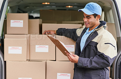 Buy stock photo Cropped shot of a delivery man standing next to a van full of boxes