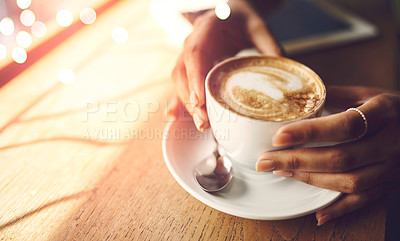 Buy stock photo Closeup shot of an unrecognizable woman having a cup of coffee at a cafe
