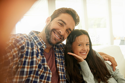 Buy stock photo Cropped shot of a father and daughter taking a selfie together