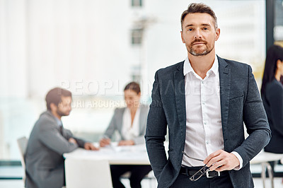 Buy stock photo Portrait of a businessman in the office with his colleagues in the background