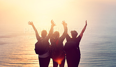 Buy stock photo Shot of a group of friends on a mountain top