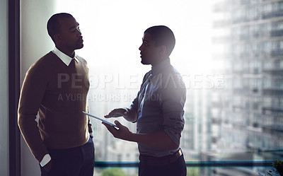Buy stock photo Cropped shot of two businessmen having a discussion in an office