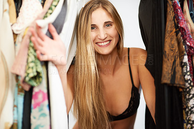 Buy stock photo Portrait of a beautiful young woman getting dressed in her bedroom at home