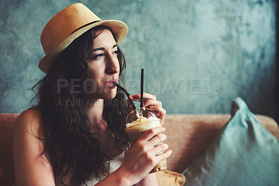 Buy stock photo Shot of a young woman enjoying a chilled coffee beverage while on vacation