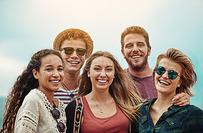Buy stock photo Portrait of a group of friends spending time together outdoors