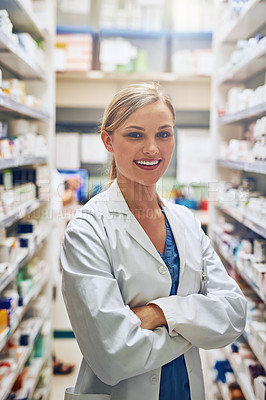Buy stock photo Portrait of a pharmacist standing in a isle with her arms crossed
