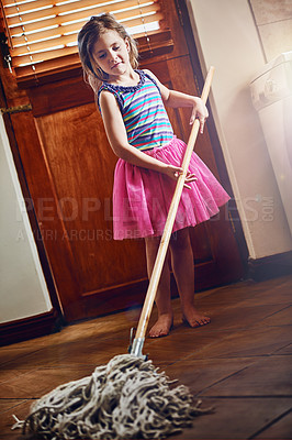 Buy stock photo Shot of a little girl mopping the floor at home