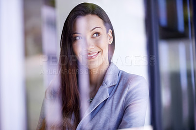 Buy stock photo Shot of a thoughtful young businesswoman working in a modern office