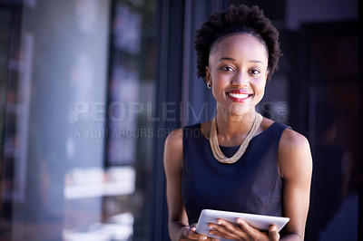 Buy stock photo Portrait of a young businesswoman using a digital tablet at work
