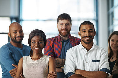 Buy stock photo Portrait of a group of confident young colleagues standing together in a modern office