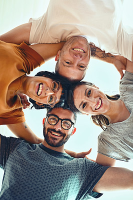 Buy stock photo Low angle portrait of a group of young designers standing in a huddle