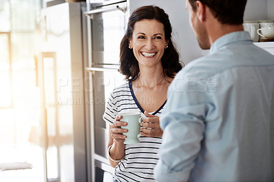 Buy stock photo Shot of a happy couple bonding at home during a coffee break