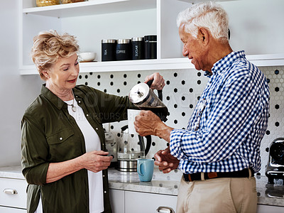 Buy stock photo Cropped shot of a senior couple drinking coffee together at home