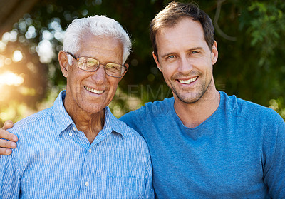 Buy stock photo Portrait of happy man posing outside with his mature father
