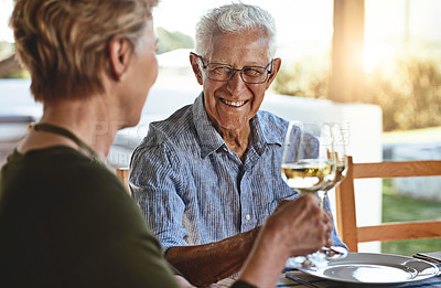Buy stock photo Shot of a happy mature couple enjoying lunch together outside